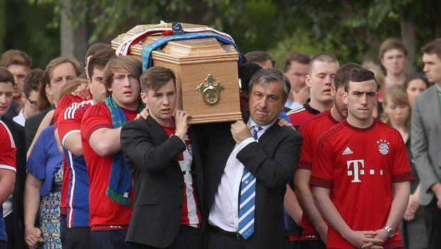 Father and brother, John and Alexei carry the coffin to the Church of the Three Patrons, Rathgar for the funeral mass of Niccolai Schuster. Picture credit; Damien Eagers 23/6/2015