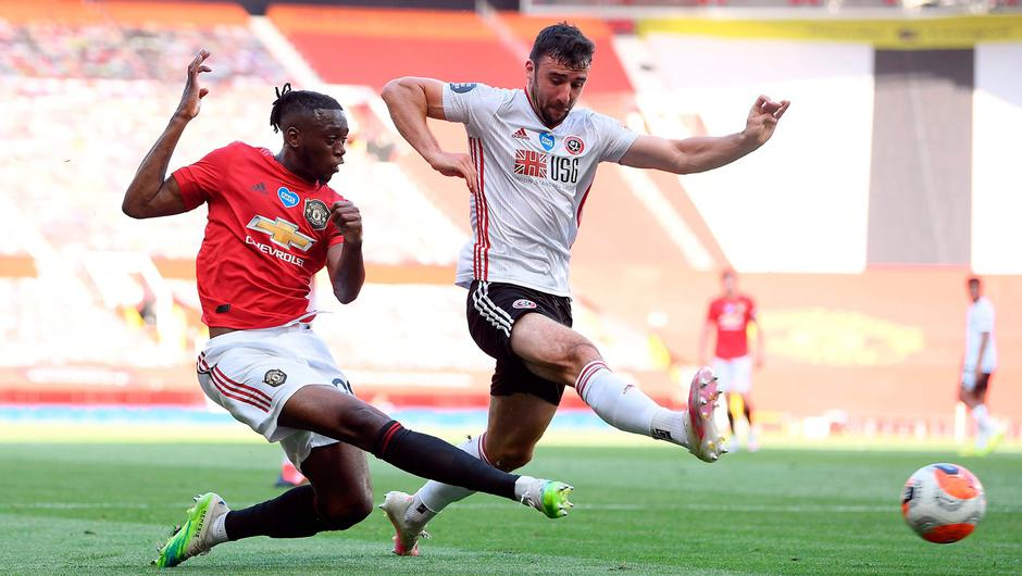 Aaron Wan-Bissaka gets past Sheffield United's Enda Stevens to deliver a cross to set up a Manchester United goal. Photo: Michael Regan/NMC Pool/PA Wire