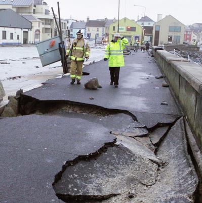 The scenes of devastation at Lahinch promenade, where massive walls and quarter tonne wall cappings were tossed across the carpark during the storm. Photo: Press 22