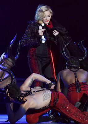 Singer Madonna struggles with her cape after falling during her performance at the BRIT music awards at the O2 Arena in Greenwich, London, February 25, 2015. REUTERS/Toby Melville (BRITAIN - Tags: ENTERTAINMENT)