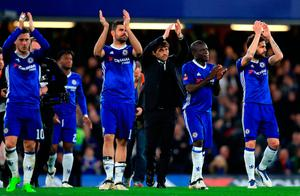 Chelsea manager Antonio Conte and players applaud the fans at full time at Stamford Bridge. PA