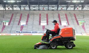 A groundsman works on the pitch after FC Augsburg v VfL Wolfsburg, as play resumed in the Bundesliga behind closed doors following the outbreak of the coronavirus disease. Tobias Hase/Pool via REUTERS