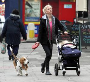 Sara Cox spotted strolling near her North London home with daughter Lola in her Bugaboo and dog Snoop.