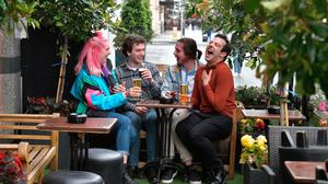 Open house: Customers enjoy a drink at Murrays pub in Dublin city centre. Photo: Charles McQuillan