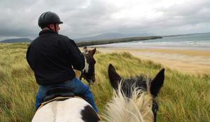 Tullan Strand, Co. Donegal: Stretching from the north end of Bundoran to the Erne estuary, surfers rank Tullan Strand as one of Ireland's most consistent beach breaks. But there's far more than surfing to it, as our photo illustrates... including horse-riding in the dunes.
