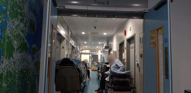 Patients lie on trolleys in the corridors of University Hospital Limerick where staff are also dealing with a winter flu outbreak