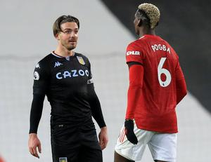 Aston Villa's Jack Grealish and Manchester United's Paul Pogba exchange words following their Premier League clash on New Year's Day. Photo: Getty Images