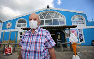 Liam Cloke, who runs the Strand Shop and Takeaway, is urging beachgoers to wear masks inside his shop Picture; Gerry Mooney