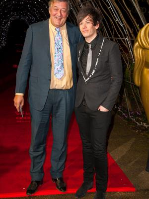 Stephen Fry (left) and his husband Elliot Spencer attend the Audi EE British Academy Film Awards Nominees Party