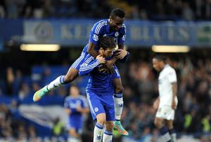 Oscar is congratulated by teammate John Mikel Obi after scoring Chelsea's winning goal in their Capital One Cup game against Bolton Wanderers at Stamford Bridge. Photo: Andrew Matthews/PA Wire