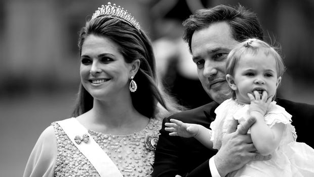 STOCKHOLM, SWEDEN - JUNE 13: (EDITORS NOTE: Image has been converted to black and white.)  Princess Madeleine of Sweden, her husband Christopher O'Neill and their daughter Princess Leonore attend the royal wedding of Prince Carl Philip of Sweden and Sofia Hellqvist at The Royal Palace on June 13, 2015 in Stockholm, Sweden.  (Photo by Ian Gavan/Getty Images)