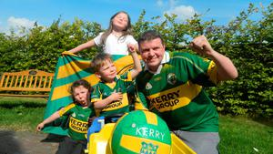 Graham Clifford, his daughters Molly (9), Aoife (7) and son Aodhan (4) getting ready for the final