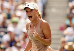 Caroline Wozniacki of Denmark celebrates a point against Shuai Peng of China during their women's singles semifinal match on Day 12 of the 2014 US Open