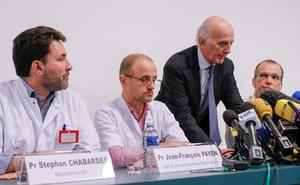 (L-R) Neurosurgeon Stephan Chabardes, Jean-Francois Payen, head anaesthetician at the CHU hospital, Professor Gerard Saillant, President of the Institute for Brain and Spinal Cord Disorders (ICM), and Emmanuel Gay, head of neurosurgery, at today's press conference.