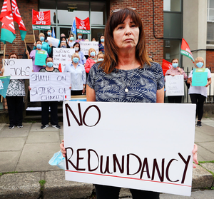 Dispute: Healthcare assistant Liz Meade protests alongside fellow staff at St Monica's Nursing Home in Belvedere Place, Dublin, one of three facilities shutting down with the loss of 180 jobs. Photo: Steve Humphreys