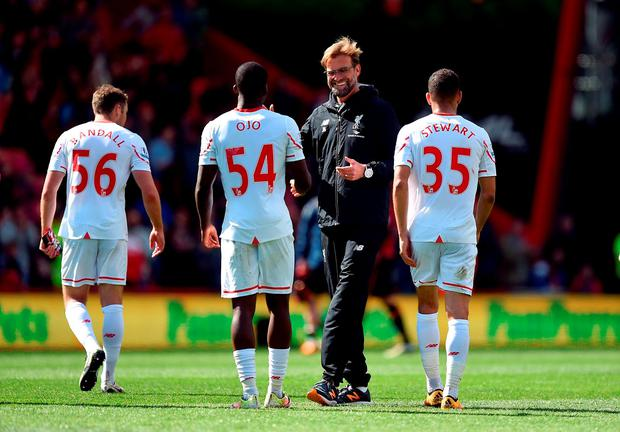 Liverpool manager Jurgen Klopp celebrates their victory over Bournemouth last month with Sheyi Ojo