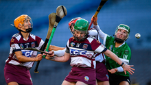 Tina Bradley, Josephine McMullan and Therese Mellon of Slaughtneil in action against Laura Ward of Sarsfields. Photo by Harry Murphy/Sportsfile
