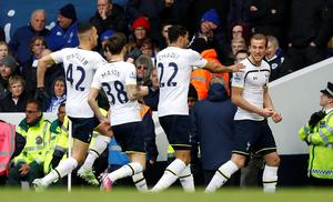 Tottenham Hotspur's English striker Harry Kane (R) celebrates with teammates after scoring the opening goal of the English Premier League football match between Tottenham Hotspur and Leicester City at White Hart Lane in London on March 21, 2015. AFP PHOTO / IAN KINGTON  RESTRICTED TO EDITORIAL USE. NO USE WITH UNAUTHORIZED AUDIO, VIDEO, DATA, FIXTURE LISTS, CLUB/LEAGUE LOGOS OR LIVE SERVICES. ONLINE IN-MATCH USE LIMITED TO 45 IMAGES, NO VIDEO EMULATION. NO USE IN BETTING, GAMES OR SINGLE CLUB/LEAGUE/PLAYER PUBLICATIONS.IAN KINGTON/AFP/Getty Images