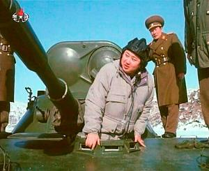North Korean leader Kim Jong-un – seen here in one of the many     propaganda  pictures depicting him as a man of action – is reported to have 'put on an alarming amount of weight, and is walking with a limp'.
