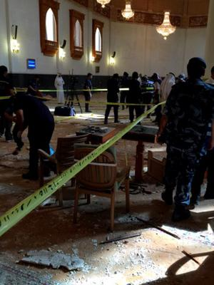 Inspectors work at the Imam Sadiq Mosque after a bomb explosion, in the Al Sawaber area of Kuwait City June 26, 2015. A suicide bomber blew himself up at the packed Shi'ite Muslim mosque in Kuwait city during Friday prayers, killing more than ten people, the governor of Kuwait City said. REUTERS/Kuwait News AgencyÄ®ATTENTION EDITORS - THIS IMAGE WAS PROVIDED BY A THIRD PARTY.  NO SALES. NO ARCHIVES.  THIS PICTURE IS DISTRIBUTED EXACTLY AS RECEIVED BY REUTERS, AS A SERVICE TO CLIENTS. FOR EDITORIAL USE ONLY. NOT FOR SALE FOR MARKETING OR ADVERTISING CAMPAIGNS.