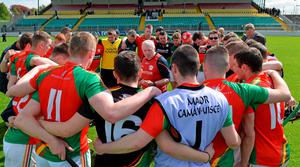 Carlow boss Pat English with his players after the game