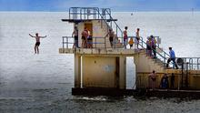 STEPPING UP: Gardai move along swimmers at the Blackrock diving tower in Salthill. Photo: Ray Ryan