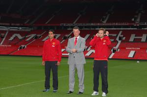 Manchester United manager Louis van Gaal (centre) with his new signings Radamel Falcao (left) and Daley Blind