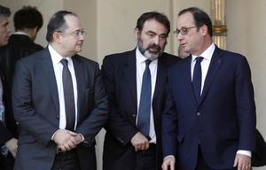 PARIS, FRANCE - JANUARY 11:  French President Francois Hollande (R) speaks with Joel Mergui (C), President of the Central Jewish Consistory of France) and representatives of French Jewish associations after a meeting at the Elysee Palace on January 11, 2015, in Paris, France. More than a million people and dozens of world leaders were expected to march through Paris on January 11 in a historic display of global defiance against extremism after Islamist attacks that killed 17 victims.  (Photo by Thierry Chesnot/Getty Images)