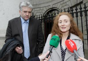 Dr Fiona Murphy and her husband Mark Dunne outside court after their son was awarded €8.5m. Photo: Collins