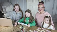 Amy McArdle with her daughters Eve (11) in sixth class, Lucia (9) in third class and Esme (5) in junior infants, who are keeping up with lessons from Faughart Community School, Co Louth, via the internet. Photo: Arthur Carron