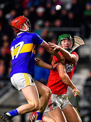 Seamus Harnedy of Cork is tackled by Jerome Cahill of Tipperary. Photo by Eóin Noonan/Sportsfile