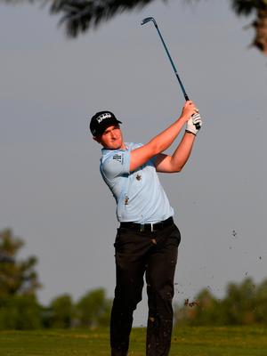 Dunne managed just eight holes of his second round, carding two birdies, two bogeys and a double bogey leaving him on two over par overall and with plenty of work to do. Photo by Ross Kinnaird/Getty Images