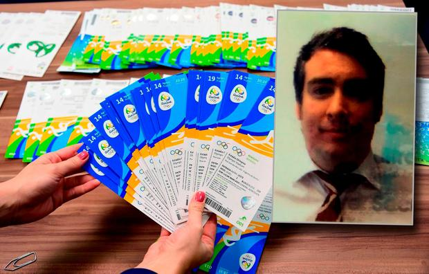 Tickets of the Rio 2016 Olympic Games seized to one of the directors of THG Sports, a company of international business events and information group Marcus Evans, Irish Kevin James Mallon (inset), are displayed during a press conference at the City Police's station in Benfica, north of Rio de Janeiro, Brazil