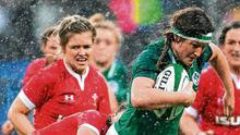 Ireland's Anna Caplice attempts to get away from the tackle of her Welsh opponent Alisha Butchers. Photo: Ramsey Cardy/Sportsfile