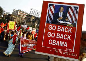 Activists from Communist Party of India-Marxist (CPI-M) hold placards and shout slogans during a protest against U.S. President Barack Obama's visit to India, in Kolkata as it has emerged Obama will cut short his visit to India to fly to Saudi Arabia (REUTERS/Rupak De Chowdhuri)