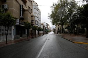 An empty street is pictured during partial lockdown as part of a 15-day state of emergency to combat the coronavirus disease (COVID-19) outbreak in downtown Ronda, southern Spain. Photo: REUTERS/Jon Nazca