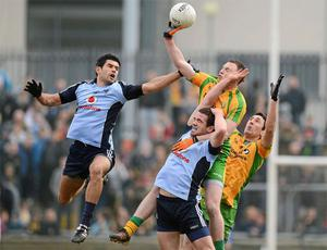 Donegal's Eamon Doherty and Rory Kavanagh battle for possession with Dublin's Cian O'Sullivan and Ger Brennan during Sunday's game which saw the All-Ireland champions relegated from Division 1, not that Jim McGuinness was too concerned