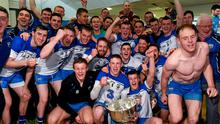 Waterford players celebrate their Allianz NHL final victory over Cork
