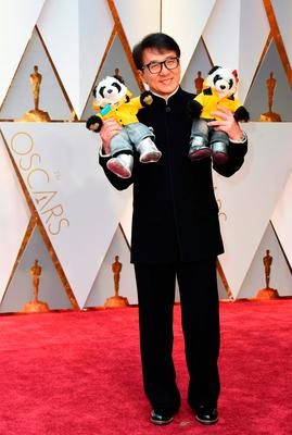 Jackie Chan arrives on the red carpet for the 89th Oscars on February 26, 2017 in Hollywood, California.  / AFP PHOTO / VALERIE MACONVALERIE MACON/AFP/Getty Images