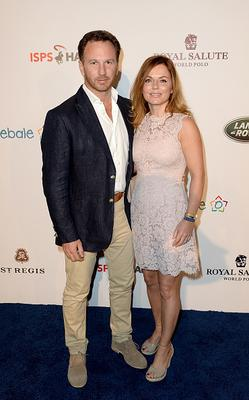 Christian Horner and Geri Halliwell attend the Sentebale Polo Cup presented by Royal Salute World Polo at Ghantoot Polo Club on November 20, 2014 in Abu Dhabi, United Arab Emirates.