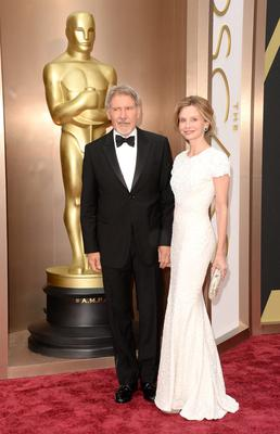 Actors Harrison Ford (L) and Calista Flockhart attend the Oscars held at Hollywood & Highland Center on March 2, 2014 in Hollywood, California.  (Photo by Jason Merritt/Getty Images)