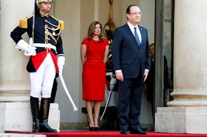 Valerie Trierweiler, former companion of French President Francois Hollande, stands behind him before a state dinner at the Elysee Palace in Paris, in this May 7, 2013 file picture (REUTERS/Charles Platiau/Files)