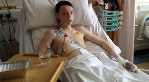 Calvin Lynch in hospital after being stabbed six times in a case of mistaken identity