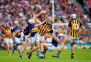Kilkenny's Richie Hogan, with Michael Fennelly in support, battles for possession with Tipperary pair Brendan Maher and Cathal Barrett during the All-Ireland hurling final at Croke Park. Photo: Ray McManus / SPORTSFILE