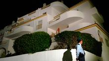 Crime scene: A photo from 2007 of a police officer outside the apartment at the Ocean Club Hotel in Luz where Madeleine McCann went missing