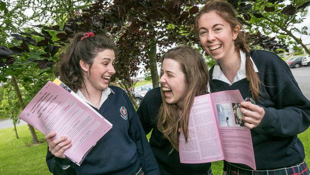 Aisling Gaule, Roisin O'Sullivan and Aisling Maguire unwind after sitting their Leaving Certificate English paper at Presentation Secondary School in Kilkenny city. Photo: Pat Moore.