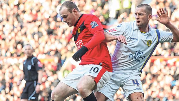 Michael Doyle battling Wayne Rooney in 2010 when Leeds knocked out Manchester United. Photo: Matthew Peters