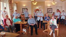 Residents and staff enjoying the annual barbecue at Middletown House nursing home