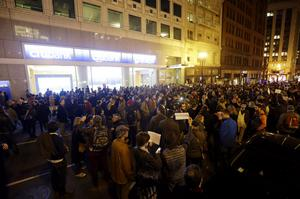 A crowd gathers outside of the French Consulate during a gathering in solidarity with those killed in an attack at the Paris offices of the weekly newspaper Charlie Hebdo on Wednesday, Jan. 7, 2015, in San Francisco.  (AP Photo/Marcio Jose Sanchez)