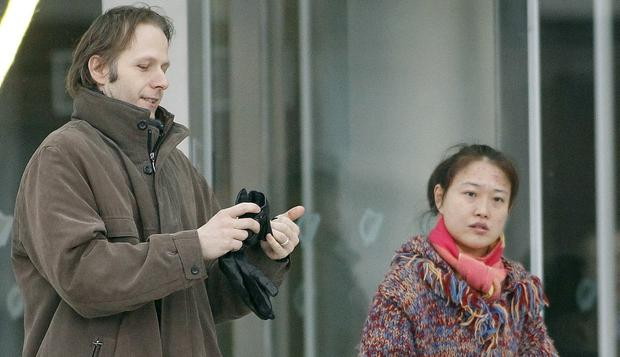 Held: Daniel Belling with his Chinese wife Xing Li, who disappeared during a cruise in 2017